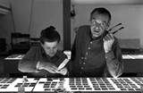 The World of Charles and Ray Eames. Charles and Ray Eames selecting slides. © Eames Office LLC